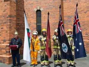 Flag-bearers (L to R): Rural Firefighter Nadine Andersen, Captain Ray Williams, Snr Firefighter Glenn Bell, and Station Officer Trevor Stark.